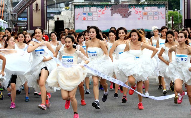 "Brides-to-be participate in the ""Running of the Brides"" race in a park in Bangkok, Thailand, November 28, 2015. (Photo by Vichan Poti/Pacific Press/SIPA Press)"