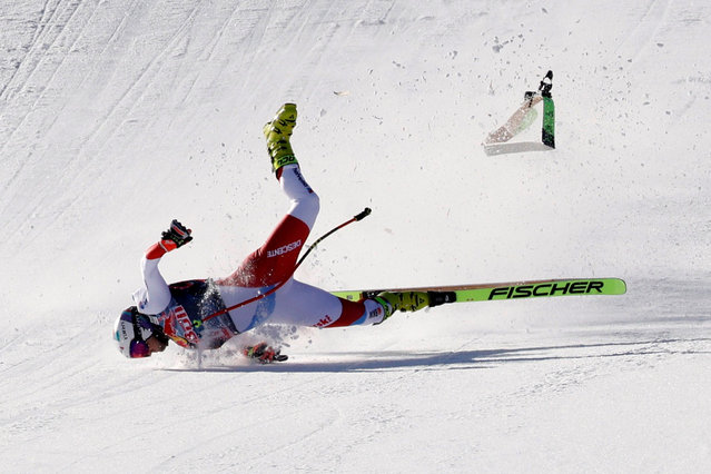 Switzerland's Urs Kryenbuehl crashes during his run during the men's downhill event at the FIS Alpine Ski World Cup, also known as Hahnenkamm race, in Kitzbuehel, Austria, on January 22, 2021. (Photo by Leonhard Foeger/Reuters)