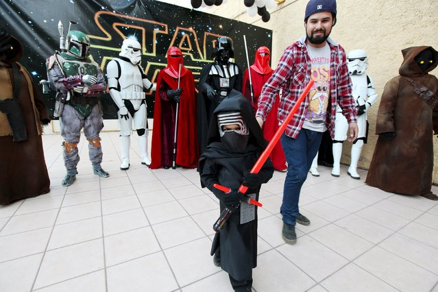 A son and his father take part in a Star Wars fan convention in Ciudad Juarez, December 5, 2015. (Photo by Jose Luis Gonzalez/Reuters)