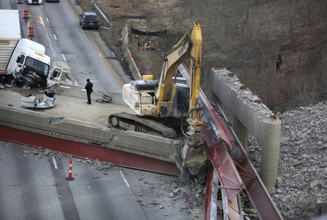 The aftermath of a bridge collapse on Interstate 75, Tuesday, Jan. 20, 2015 in Cincinnati, Ohio. The collapse killed a worker and injured a truck driver. The Ohio Department of Transportation said the busy artery through downtown Cincinnati will be closed at least two to three days. (AP Photo/The Enquirer, Liz Dufour)