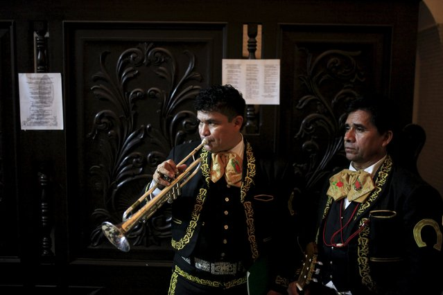 Mariachi musicians prepare to perform to celebrate the Day of the Virgin of Guadalupe outside the Basilica of Guadalupe in San Salvador, El Salvador December 11, 2015. (Photo by Jose Cabezas/Reuters)