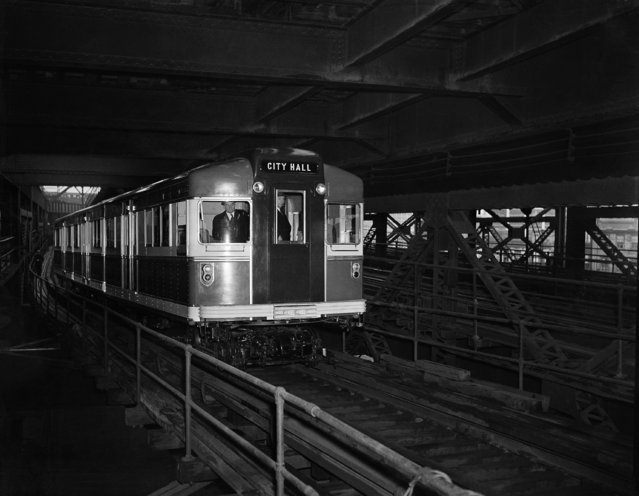 """The new streamlined red, white and blue Rapid Transit car which made its """"maiden voyage"""" along the BMT lines in New York, March 28, 1939. It weighs 76,000 pounds, about half the weight of the conventional cars, and is equipped with special sound-deadening and shock-cushioning devices. (Photo by AP Photo)"""