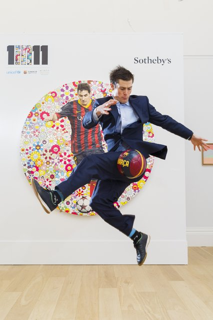 To announce Sotheby's forthcoming auction on the 12th of February 2015 in support of the 1 in 11 campaign led by Lionel Messi, FC Barcelona Foundation, Unicef and Rota, football freestyle world champion John Farnworth performs in front of  'Lionel Messi and a Universe of Flowers' by Takashi Murakami at Sotheby's on February 6, 2015 in London, England. (Photo by Tristan Fewings/Getty Images for Sotheby's)