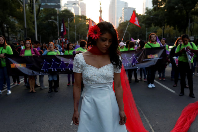 A woman takes part in a demonstration to commemorate the U.N. International Day for the Elimination of Violence against Women in Mexico City, Mexico, November 25, 2016. (Photo by Carlos Jasso/Reuters)