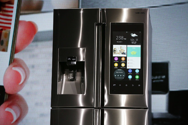 The Samsung Family Hub refrigerator, which is connected and features a 21.5 inch full HD LCD screen, with internal cameras to check what is left inside, and online grocery shopping through major credit cards, is introduced during a press event for CES 2016 at the Mandalay Bay Convention Center on January 5, 2016 in Las Vegas, Nevada. (Photo by Alex Wong/Getty Images)