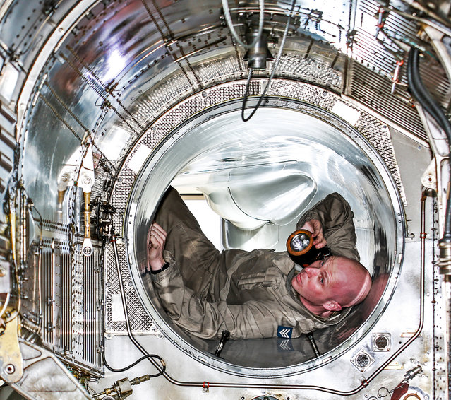 """""""Tunnel Vision"""". Technical and engineering, third prize: Sgt Danny Wass of IX Squadron, 903 Expeditionary Air Wing inspects an engine bay of a Tornado GR4 aircraft. (Photo bu SAC Phil Dye/RAF)"""