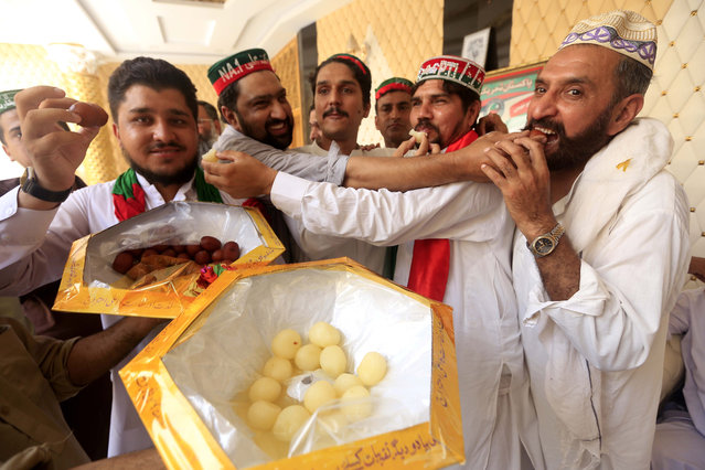 Supporters of Pakistan Tehreek-e-Insaf (PTI) celebrate a day after general elections in Peshawar, Pakistan, 26 July 2018. Millions of Pakistanis turned out for parliamentary elections on 25 July, despite the threat of violence by extremist militant groups. Voters had to choose from 11,000 candidates to elect 272 members of the Parliament for the next term. (Photo by Bilawal Arbab/EPA/EFE)