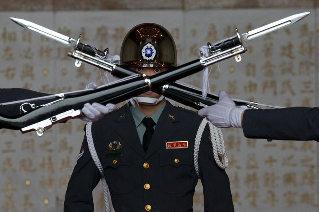 A member of the Taiwanese honor guard takes part in a change of duty ceremony at the Chiang Kai-shek Memorial Hall in Taipei, Taiwan, Friday, January 15, 2016. Taiwan will hold its presidential election on Saturday, Jan. 16. (Photo by Ng Han Guan/AP Photo)