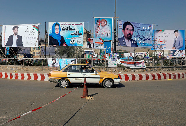 A vehicle drives in front of election posters of parliamentarian candidates installed during the first day of elections campaign in Kabul, Afghanistan September 28, 2018. (Photo by Omar Sobhani/Reuters)