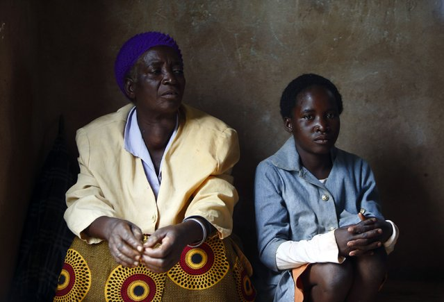 11-year-old Emery Phiri (right), who was born HIV-positive, and her grandmother attend a self-help group meeting with a caregiver in the village of Michelo, south of the Chikuni Mission in the south of Zambia February 23, 2015. (Photo by Darrin Zammit Lupi/Reuters)
