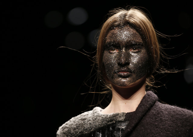 A model wears a creation for Claudio Cutugno women's Fall-Winter 2015-16 collection, part of the Milan Fashion Week, unveiled in Milan, Italy, Tuesday, February 24, 2015. (Photo by Luca Bruno/AP Photo)
