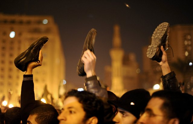 Anti-government protesters in Cairo's Tahrir Square wave shoes in dismay as President Hosni Mubarak speaks to the nation February 10, 2011. (Photo by Dylan Martinez/Reuters)