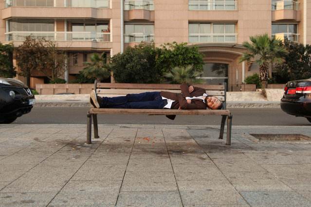 A man sleeps at Beirut's Corniche, a seaside promenade, in Lebanon May 2, 2016. (Photo by Alia Haju/Reuters)