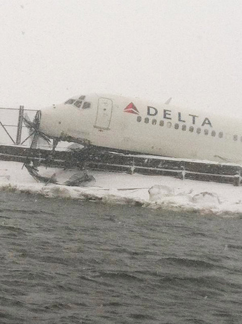 NEW YORK, NY - MARCH 5:  In this handout from the New York City Fire Department (FDNY), A Delta Air Lines jetliner rests on a berm at LaGuardia Airport  March 5, 2015 in Queens, New York City. Delta flight 1086, flying to New York from Atlanta, reportedly skidded off the runway after it landed during a snowstorm.  (Photo by New York City Fire Department (FDNY) via Getty Images)