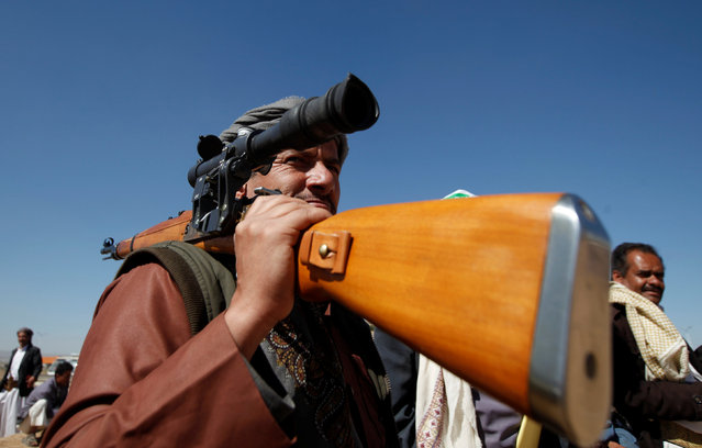 A tribesman holds a weapon as he attends a gathering held to show support to the new government formed by Yemen's armed Houthi movement and its political allies, in Sanaa, Yemen December 6, 2016. (Photo by Khaled Abdullah/Reuters)