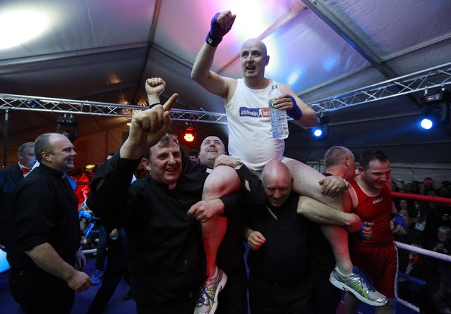 Fr Pierre Pepper is carried aloft after defeating Jared Madden during his amateur boxing match in the town of Banagher in County Offaly March 15, 2015. (Photo by Cathal McNaughton/Reuters)