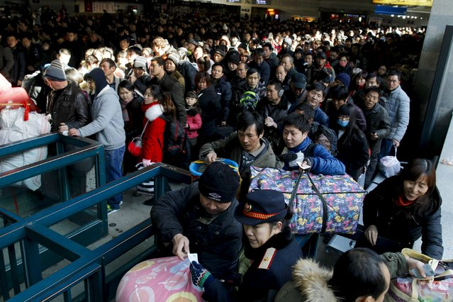 Passengers wait for boarding at Beijing West Railway station, China, January 24, 2016. (Photo by Reuters/China Daily)