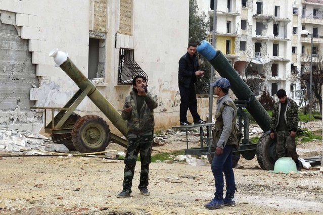 Rebel fighters prepare a mortar at al-Breij frontline, after what they said was an advance by them in al-Manasher and al-Majbal areas where forces loyal to Syria's President Bashar al-Assad were stationed, in Aleppo January 5, 2015. Picture taken January 5, 2015. (Photo by Abdalghne Karoof/Reuters)