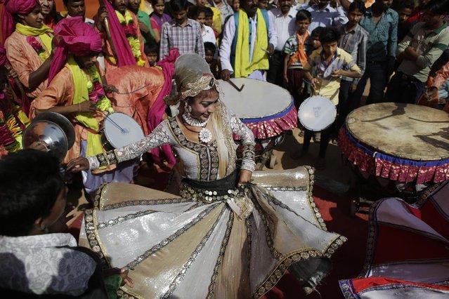 A woman dances during a religious procession on Ram Navami festival in New Delhi, India, Saturday, March 28, 2015. (Photo by Altaf Qadri/AP Photo)
