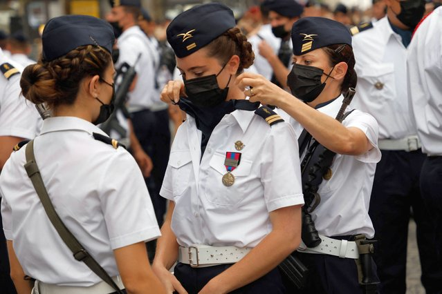 Soldiers of the French Air and Space Force who took part in the Skyros Operation get ready prior to the annual Bastille Day military parade on the Champs-Elysees avenue in Paris on July 14, 2021. (Photo by Ludovic Marin/AFP Photo)