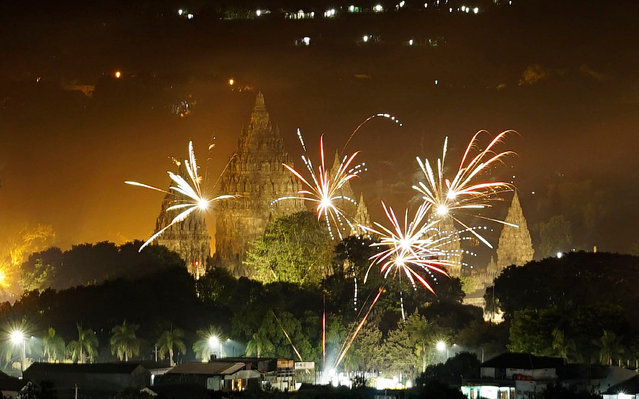 Fireworks seen over Prambanan temple complex during a countdown event to celebrate the New Year on January 1, 2017 in Yogyakarta, Indonesia. (Photo by Jefta Images/Barcroft Images)