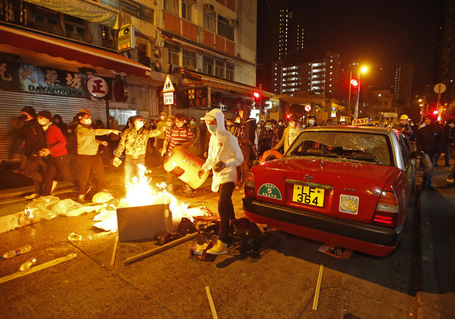 Rioters set fires on streets in Mongkok district of Hong Kong, Tuesday, February 9, 2016. (Photo by Kin Cheung/AP Photo)