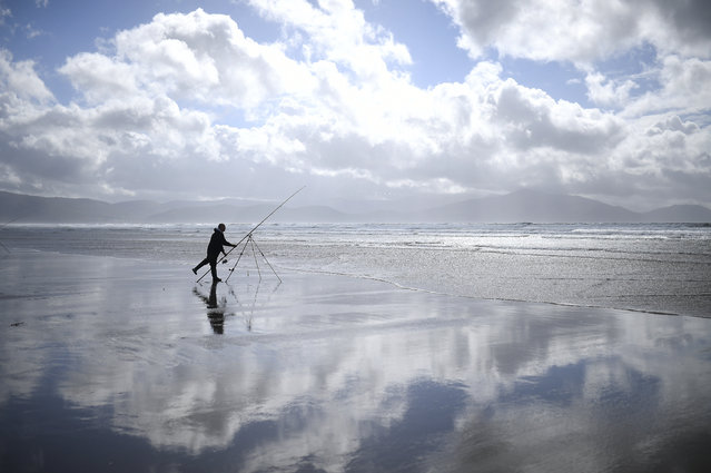A man participates in the Diawa Irish Pairs sea angling event in windy conditions on the Dingle Peninsula of Inch beach in Inch, Ireland, September 18, 2018. (Photo by Clodagh Kilcoyne/Reuters)