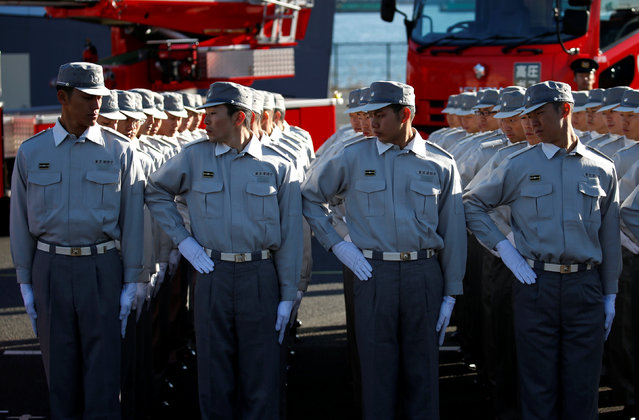 Members of Tokyo Fire Department line up during a New Year demonstration by the fire brigade in Tokyo, Japan, January 6, 2017. (Photo by Toru Hanai/Reuters)