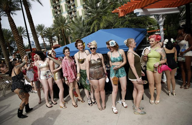 In this April 5, 2015, photo, women wait in line before taking part in a bathing suit contest at the Viva Las Vegas Rockabilly Weekend in Las Vegas. Many of the attendees of the weekend wear vintage clothes. (Photo by John Locher/AP Photo)