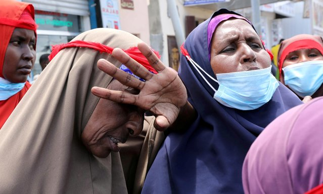Habiba Abdi Aden, a Somali woman mourns her son at a protest against the African Union Mission in Somalia (AMISOM) outside Erdogan Hospital following the killing of civilians during a gunfight between AMISOM and al Shabaab fighters in the Lower Shabelle region, in Mogadishu, Somalia on August 12, 2021. (Photo by Feisal Omar/Reuters)