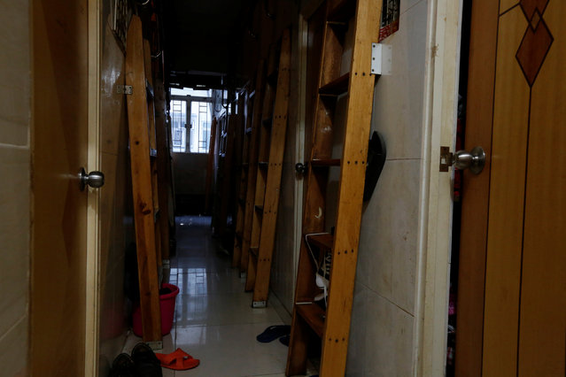"""A corridor with ladders is seen inside a flat filled with partitioned units, or """"coffin units"""", in Hong Kong, China October 31, 2016. (Photo by Bobby Yip/Reuters)"""