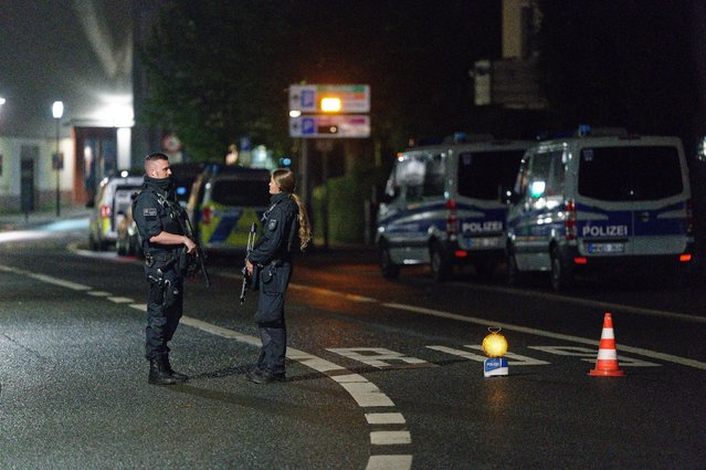 Police officers block a street in the city center during a police operation protecting the Jewish Community building in Hagen, Germany, Thursday, September 16, 2021. Numerous police officers were involved in the operation, the police spoke of indications of a possible dangerous situation. (Photo by Henning Kaiser/dpa via AP Photo)