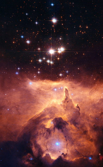 This image made by the NASA/ESA Hubble Space Telescope shows the star cluster Pismis 24 in the core of the large emission nebula NGC 6357. Part of the nebula is ionised by the youngest (bluest) heavy stars emitting intense ultraviolet radiation, heating the gas surrounding the cluster and creating a bubble in NGC 6357. (Photo by NASA/ ESA, Jesus Maiz Apellaniz – Instituto de Astrofisica de Andalucía, Spain via AP Photo)