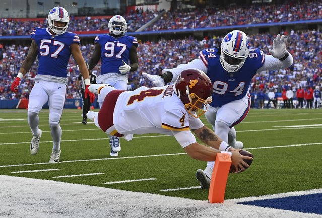 Washington Football Team quarterback Taylor Heinicke (4) dives into he end zone for a touchdown during the second quarter in a game between the Buffalo Bills and Washington Football Team at Highmark Stadium on September 26, 2021 in Orchard Park, NY. (Photo by Ricky Carioti/The Washington Post)