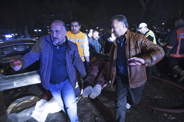 People carry a person wounded in an explosion in Ankara, Turkey, Sunday, March 13, 2016. At least 37 people have died after a car bomb exploded in the Turkish capital Ankara, less than a month after a suicide car bomber killed dozens of military personnel and civilians in the city. Mehmet Muezzinoglu, the health minister, said a further 71 people were still being treated in hospital, with 15 in a serious condition. President Recep Tayyip Erdoğan vowed to defeat terrorists who have staged a series of attacks on Turkey in the past 18 months. (Photo by Osmancan Gurdogan/Depo Photos via AP Photo)