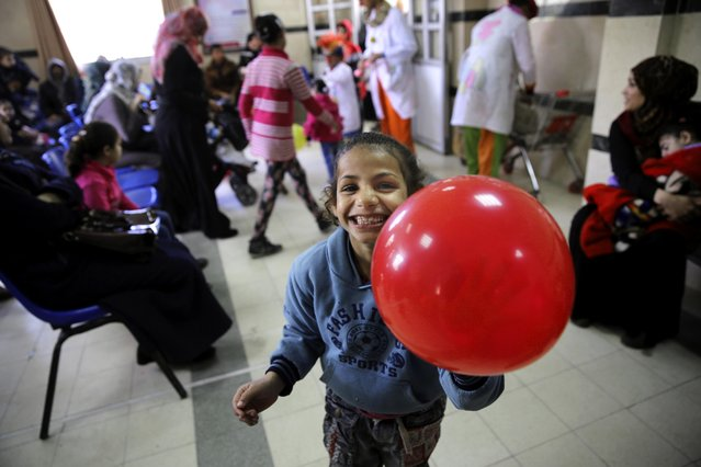 In this Thursday, March 17, 2016 photo, a child laughs during the visit of Palestinian clown doctors, Majed Kaloub, and Alaa Miqdad, at the Al-Rantisi children's hospital in Gaza Cit. (Photo by Adel Hana/AP Photo)