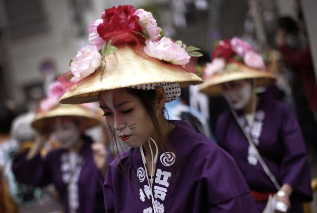 Participants prepare to parade through precincts of the Kanda Myojin shrine during the annual summer festival in Tokyo, Saturday, May 9, 2015. (Photo by Eugene Hoshiko/AP Photo)