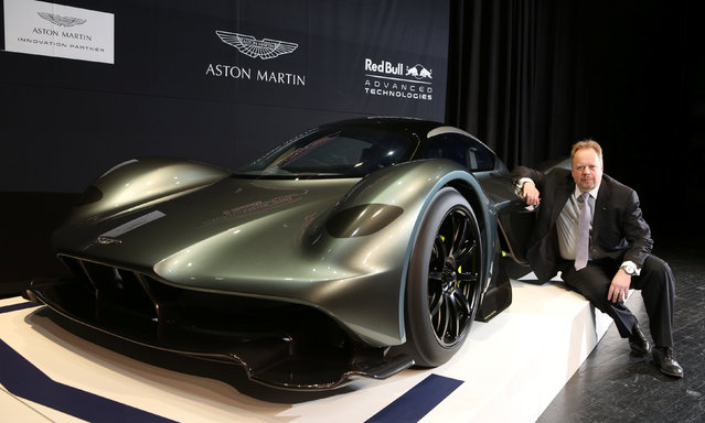 Aston Martin CEO Andy Palmer poses with the display model of a AM-RB 001 ahead of the 2017 Canadian International Autoshow where the company and Red Bull Racing reveal the $3 million Aston Martin AM-RB 001 hypercar in Toronto, Ontario, Canada, February 15, 2017. (Photo by Peter Power/Reuters)