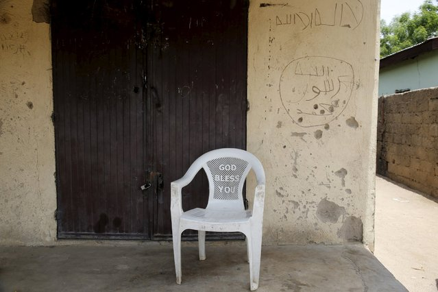 A sign is seen inscribed on a wall in front of a shop in Michika town, after the Nigerian military recaptured it from Boko Haram, in Adamawa state May 10, 2015. (Photo by Akintunde Akinleye/Reuters)