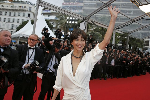 "Jury member actress Sophie Marceau poses on the red carpet as she arrives for the screening of the film ""Mad Max: Fury Road"" out of competition at the 68th Cannes Film Festival in Cannes, southern France, May 14, 2015. (Photo by Benoit Tessier/Reuters)"