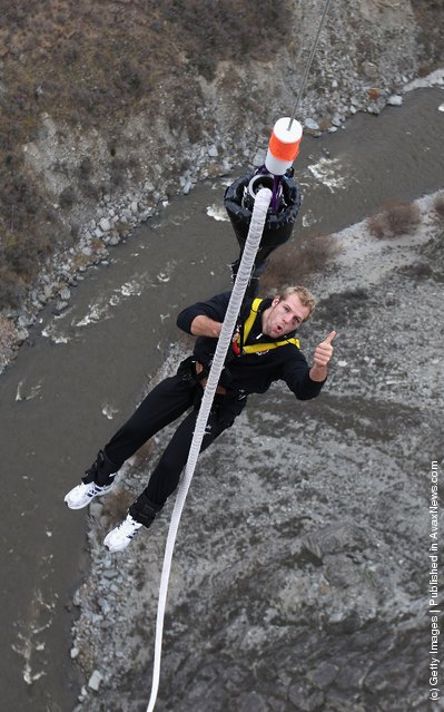 James Haskell, the England flank forward, is hoisted back up after his bungy jump at the 134 meter high Nevis Bungy jump during an England IRB Rugby World Cup 2011