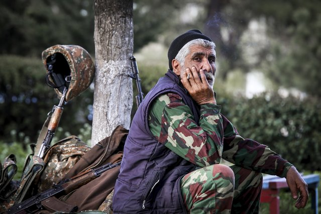 In this photo taken Saturday, April 2, 2016, an Armenian volunteer is in a state of readiness in the town of Askeran in the separatist Nagorno-Karabakh region. Officials in Azerbaijan and the separatist region of Nagorno-Karabakh say fighting is persisting a day after the worst outburst of hostilities in nearly 20 years killed 30 soldiers. Nagorno-Karabakh, part of Azerbaijan, has been under the control of local ethnic Armenian forces and the Armenian military since a war ended in 1994 with no resolution of the region's status. (Photo by Hrayr Badalyan/PAN Photo via AP Photo)