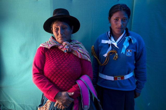 Yoana Inostroza, 17, right, waits with her mother Virtilia Inostroza, 53, to be attended by an obstetrician in Surcubamba, Peru, Thursday, May 21, 2015. (Photo by Rodrigo Abd/AP Photo)
