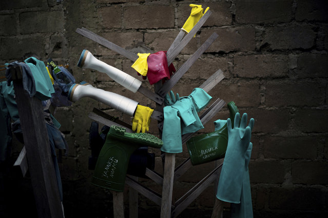 In this Friday, July 12, 2019 photo, rubber gloves and boots used by health workers treating Ebola patients are hung to dry after being disinfected at an Ebola treatment center in Beni, Congo. The World Health Organization says as many as 90 percent of those eligible for vaccination have accepted it, but that figure only includes those who gave contact tracers enough information to be included on a list. The success rate excludes those who distrusted health workers and fled, or those who couldn't be found in the first place. (Photo by Jerome Delay/AP Photo)