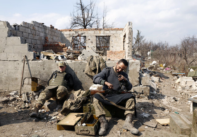 An Ukrainian serviceman prepares ammunition for the fighting with pro- Russian separatists in Avdiivka, Donetsk region on March 30, 2017. (Photo by Anatolii Stepanov/AFP Photo)