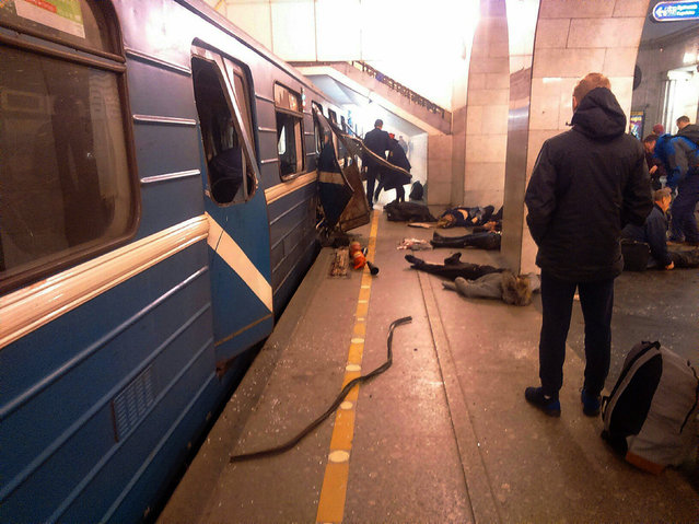 Blast victims lie near a subway train hit by a explosion at the Tekhnologichesky Institut subway station in St.Petersburg, Russia, Monday, April 3, 2017. The subway in the Russian city of St. Petersburg is reporting that several people have been injured in an explosion on a subway train. (Photo by AP Photo/DTP&ChP St. Peterburg via AP Photo)