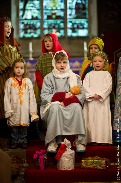 Children perform during a traditional Christmas Nativity