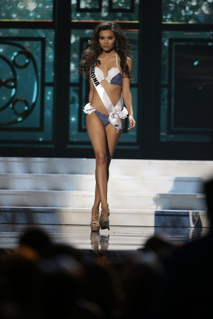 Miss Arizona, Maureen Montagne, competes in the swimsuit competition during the preliminary round of the 2015 Miss USA Pageant in Baton Rouge, La., Wednesday, July 8, 2015. (Photo by Gerald Herbert/AP Photo)