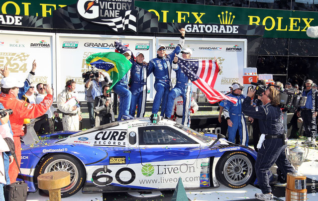 Drivers of the #60 Michael Shank Racing with Curb-Agajanian - Ford Riley celebrate after winning the Rolex 24 at Daytona International Speedway