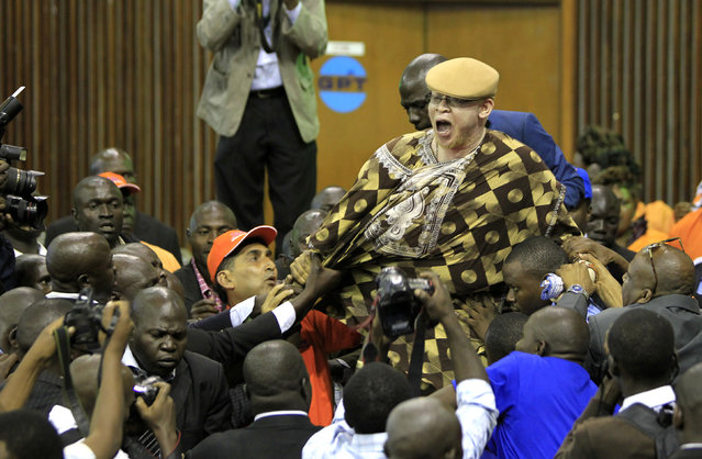 A nominated Member of Parliament Isaac Mwaura is ejected as he protests during the Orange Democratic Movement (ODM) National Delegates Convention to elect new party national office bearers in Nairobi, Kenya, February 28, 2014. (Photo by Noor Khamis/Reuters)